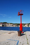 Mali Losinj harbour,Croatia. Red lighthouse and ship's buoy in Mali Losinj harbour in a sunny summer day Stock Images