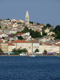 Mali Losinj panoramic view,Croatia. Panoramic waterfront view at Mali Losinj with a houses and church in a sunny summer day with blue sky Stock Image