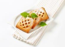 Mali morelowi kulebiaki fotografia stock