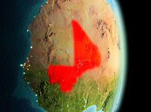 Mali in morning from orbit. Early morning view of Mali highlighted in red on planet Earth. 3D illustration. Elements of this image furnished by NASA Royalty Free Stock Photo