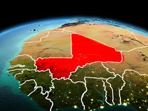 Mali on planet Earth in space. Morning above Mali highlighted in red on model of planet Earth in space with visible border lines and city lights. 3D illustration Royalty Free Stock Images