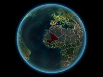 Mali on planet Earth from space at night. Mali in red with visible country borders and city lights from space at night. 3D illustration. Elements of this image Royalty Free Illustration