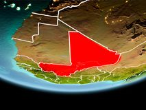 Mali in red in the evening. Country of Mali in red on planet Earth in the evening with visible border lines and city lights. 3D illustration. Elements of this Royalty Free Stock Image