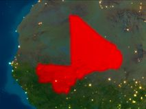 Mali in red at night. Satellite night view of Mali highlighted in red on planet Earth. 3D illustration. Elements of this image furnished by NASA Royalty Free Stock Image