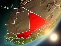 Sun rising above Mali from space. Mali from space with highly detailed surface textures and visible country borders. 3D illustration. Elements of this image Stock Illustration
