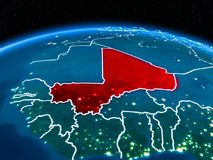 Mali from space at night. Orbit view of Mali highlighted in red with visible borderlines and city lights on planet Earth at night. 3D illustration. Elements of Stock Photo