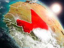 Mali from space during sunrise. Sunset above Mali from space on planet Earth with visible country borders. 3D illustration. Elements of this image furnished by Royalty Free Stock Images