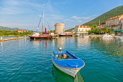 Mali Ston harbor on Peljesac. Harbor in Mali Ston and remains of the ancient walls and fortress on Peljesac peninsula Royalty Free Stock Image