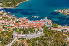Mali Ston. Medieval town Mali Ston in Dubrovnik area at the one end of the world known Ston walls. Second in world the longest defense wall with fortress Koruna royalty free stock photos