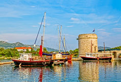 Mali Ston on Peljesac peninsula. Boats anchored in Harbor Mali Ston by the old tower Toljevac whitch is the part of the remains of the ancient walls and fortress Royalty Free Stock Photos