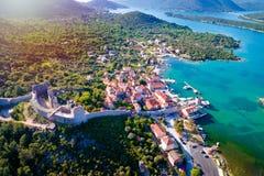 Mali Ston waterfront aerial sun haze view. Ston walls in Dalmatia region of Croatia stock photos