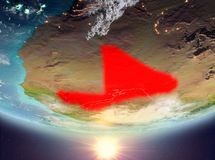 Mali with sun. Mali during sunrise highlighted in red on planet Earth with clouds. 3D illustration. Elements of this image furnished by NASA Stock Images