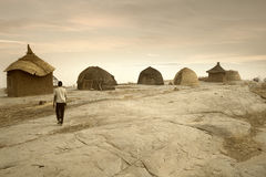 Mali, West Africa - Peul village and typical mud buildings. With barns for cereals, Fulani popolations Stock Images