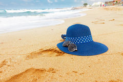 Malia beach, Crete, Greece. Blue hat at sandy beach with sea waves , Greece Royalty Free Stock Image