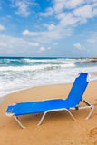 Malia beach, Crete, Greece. One blue chair on Malia beach, Crete, Greece Royalty Free Stock Images