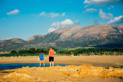 Pair of young people, a woman and a man, admire the view of the mountains during the Royalty Free Stock Photos