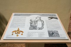 Malia ruins sign, Crete. Information sign for the Palace of Malia Minoan ruins site showing the golden bee pendant, Malia, Crete, Greece, Europe Stock Image