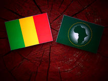 Malian flag with African Union flag on a tree stump stock image