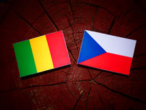 Malian flag with Czech flag on a tree stump  Royalty Free Stock Images