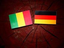 Malian flag with German flag on a tree stump  Stock Photography