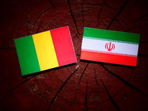 Malian flag with Iranian flag on a tree stump isolated Stock Photo