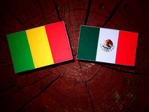 Malian flag with Mexican flag on a tree stump isolated Royalty Free Stock Photography
