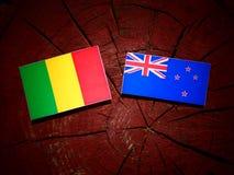Malian flag with New Zealand flag on a tree stump isolated. Malian flag with New Zealand flag on a tree stump royalty free stock photos