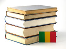 Malian flag with pile of books  on white background. Malian flag with pile of books  on white Royalty Free Stock Images