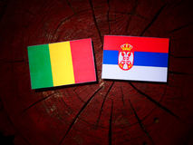 Malian flag with Serbian flag on a tree stump isolated Stock Image