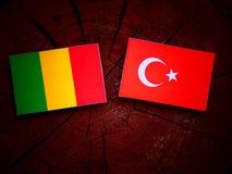 Malian flag with Turkish flag on a tree stump stock photos