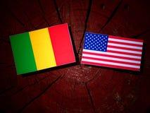 Malian flag with USA flag on a tree stump royalty free stock photo