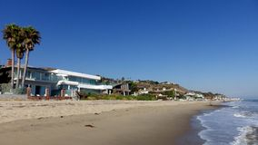 Malibu Beach, California, United States. Ocean, Beach, Palms and Modern Architecture Stock Image