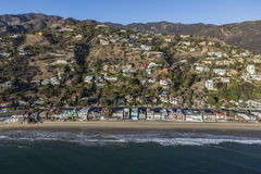 Malibu Beach and Hillside Homes Aerial near Los Angeles. Beachfront and hillside homes aerial in Malibu near Los Angeles in Southern California Royalty Free Stock Photo