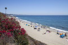Malibu Beach Summer. Malibu, California, USA - August 15, 2015:  Summer weekend beach goers enjoying the water Topanga State Beach in Santa Monica Bay Royalty Free Stock Photos