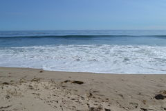 Malibu Beach. Waves hitting the sand on the Malibu coast Stock Photo