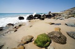 Malibu Beachscape 11. Landscape of Malibu Beach in California showing algae covered rocks Royalty Free Stock Image