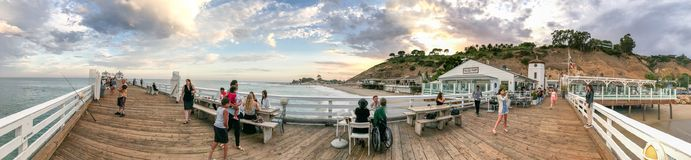 MALIBU, CA - AUGUST 1, 2017: Tourists in Malibu Pier at sunset. Malibu is a famous tourist destination in California Royalty Free Stock Images