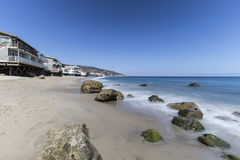 Malibu California Carbon Beach. Oceanfront homes with motion blur water movement at Carbon Beach in Malibu, California Royalty Free Stock Photo