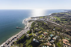 Malibu California Pier and Ocean View Estates Aerial. Aerial view of Pacific Ocean view estates and pier in Malibu, California Stock Images