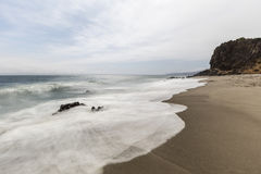 Malibu California Pirates Cove Beach with Motion Blur. Secluded Pirates Cove Beach with motion blurred water at Point Dume State Park in Malibu, California Stock Image