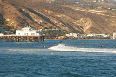 Malibu, California, USA - September 2016: Surfing people ride on the waves Stock Images