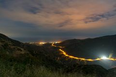 Malibu Canyon Overlook. Long exposure shot of cars going uphill on Malibu Canyon Road,shot from Malibu Canyon Overlook,as the night falls onto the the canyons Stock Photos