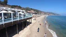 Malibu Carbon Beach. Malibu, California, United States - August 7, 2018: scenic coastal landscape with Santa Monica Mountains, Malibu Farm and turquoise sea of stock footage