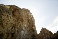 Malibu Cliff 1. View of granite cliffs in Malibu, at Point Dume with a rock climber Stock Images