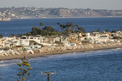 Malibu Colony Beach Ocean Homes. Malibu Colony ocean front homes with Santa Monica Bay and Los Angeles California in background Royalty Free Stock Image