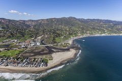 Malibu Colony, Lagoon and Surfrider Beach Aerial. Aerial view of the Malibu Colony neighborhood, Malibu Lagoon and Surfrider Beach in Southern California royalty free stock photography