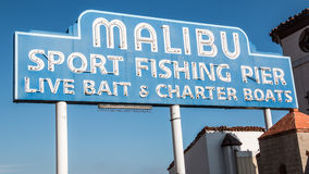 Malibu Famous Sign. Iconic sign marking the Malibu Pier, along the Pacific Coast Highway in southern California. Malibu sport fishing pier, live bait & charter Stock Photography