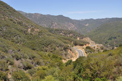 Malibu Mountain Road. This is a photograph of a winding road in Malibu, California. Malibu is the home of many famous celebrities. It has some of the most Royalty Free Stock Photography