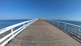 Malibu paradise Cove Pier. Paradise Cove Pier, a wooden pier in Paradise Cove beach, Malibu, California, United States. Luxurious destination on Pacific Coast stock video footage