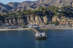 Malibu Pier Aerial. Malibu, California, USA - December 17, 2016:  Afternoon aerial of Malibu Pier and the Santa Monica Mountains Stock Photography